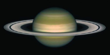 Planet Saturn and its rings. One can assume that a black hole accretion disc, although made of hot gas instead of rocks and ice, has a similar shape, namely circular thin rings.